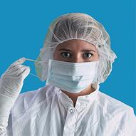 Lab Worker Putting on Disposable Cleanroom Apparel